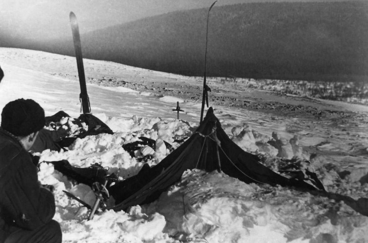 Dyatlov Pass: The tent partly cleared of the snow, 27 Feb 1959 - Yuri Koptelov in the frame, photo by V. Brusnitsyn