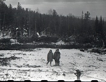Clearing for the landing site at the base camp on Auspiya. Work began on Mar 4. An antenna from a radio station is visible in the foreground.