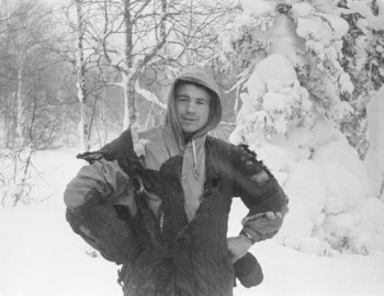 Slobodin in a burned quilted jacket. A watch is visible on his left hand. Feb 1.