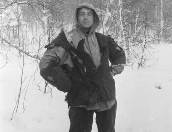 Slobodin in a burned quilted jacket. An ice ax is visible at his feet (loose frame). Feb 1.