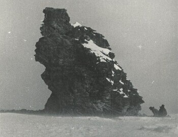 "Photo by Grigoriev from Mar 13. On the back: ""Photo №2. The outlier rock near the place of death of Dyatlov group"""