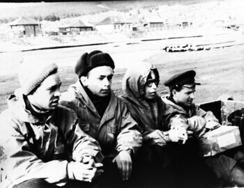 According to Askinadzi, the group travels by truck to a military helicopter parked in the far corner of the airfield. From left to right: Askinadzi-Suvorov-Mohov-Kuznetsov (with a box of butter)