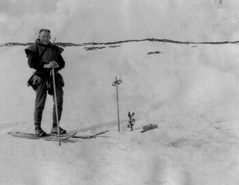 "Stepan Kurikov at the location of Dyatlov group tent before the bodies were found in the stream; the place of the tent was marked with ski poles, to which the ""buoy"" was tied."
