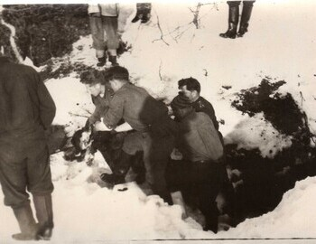 """Colonel Ortyukov, soldiers, Mohov backwards. Presumably the lifting of Kolevatov's body. On the right (covered with snow) - a waterfall and an excavation with bodies."" - Mohov's comments from Feb 1, 2012."
