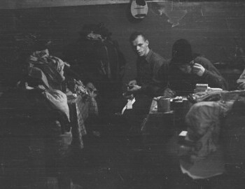 Slobodin (at the table), Dyatlov, Thibeaux-Brignolle, and Dubinina. Visible mandolin (Krivonischenko's) and a knife. Jan 24.