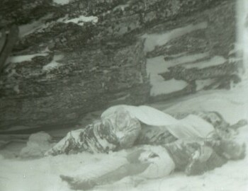 Bodies at the outlier rock. The farthest is Doroshenko; Kolmogorova lies, leaning against Dyatlov (under the sheet); Krivonischenko is in the foreground. Photo from Mar 1.