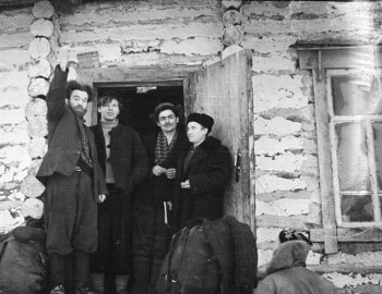 Jan 27 - District 41. Preparing to leave. Standing on the porch: Ognev-?-?-Venediktov? (with the book). Dyatlov with his back.