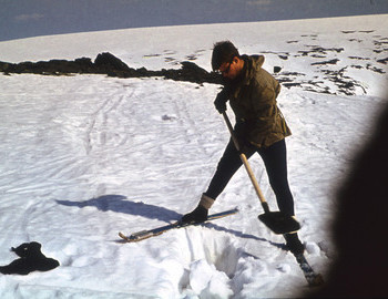 Yuri Kozin excavation snow near where a piece of clothing was found.