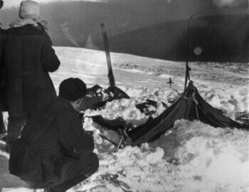 The tent partly cleared of the snow, 27 Feb 1959 - Vladislav Karelin and Yuri Koptelov, photo by Vadim Brusnitsin, photo archive Aleksej Koskin