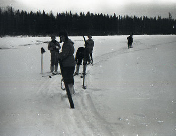 Photo by Semyon Zolotarev. Dyatlov group along Lozva river on their way to 2nd Northern. Doroshenko, Kolmogorova bent over, Krivonischenko, and Dubinina.