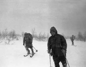 Igor Dyatlov (front), Nikolay Thibeaux-Brignolle (left), Lyuda Dubinina (right). Strong head wind, hikers are above tree line.