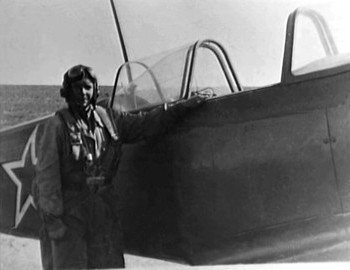 Gennadiy Vasilyevich Patrushev with a Yak 9 fighter