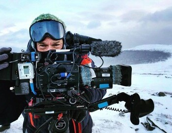 10.II.2019 - Filming on Dyatlov Pass, Evan Stone, the forest with the Siberian cedar where the bodies were found is behind him.