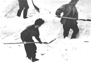 Suvorov and other rescuers digging up the den
