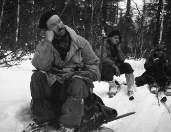 Semyon Zolotaryov, Yuri Doroshenko and Igor Dyatlov (reading the map) on a break on Lozva river on 29 Jan 1959