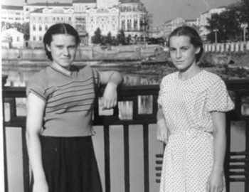 Zina (left) with a friend on the embankment of working youth at the city pond